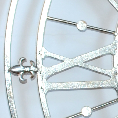 close up Silver Iron Skeleton Wall Clock