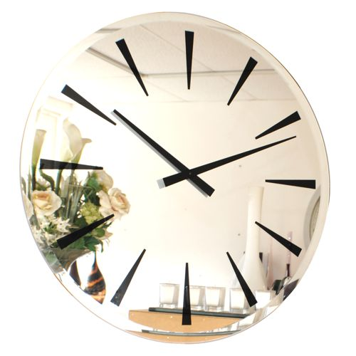 large round bevelled mirror wall clock with black digits and hands