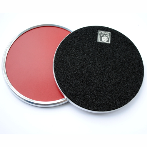 two metal rimmed round leather coasters one showing the black rubber reverse