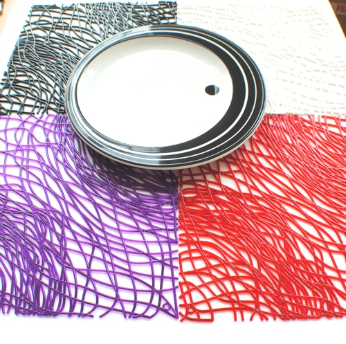 multi coloured place-mats made up of strands of acrylic