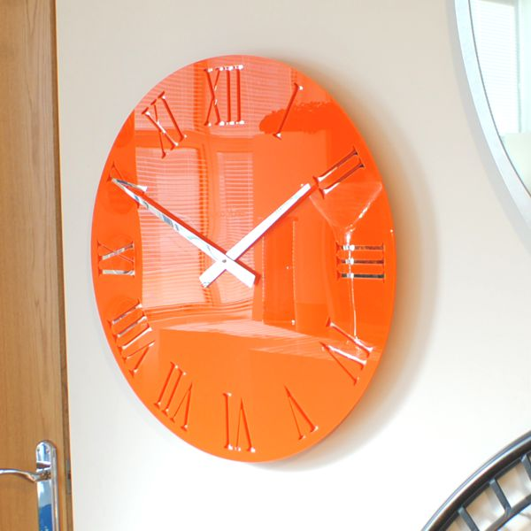 gloss orange wall clock on wall