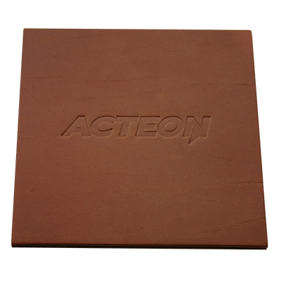 dark tan square leather coaster with embossed company logo