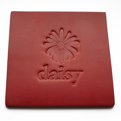 dark red square leather coaster with embossed company logo