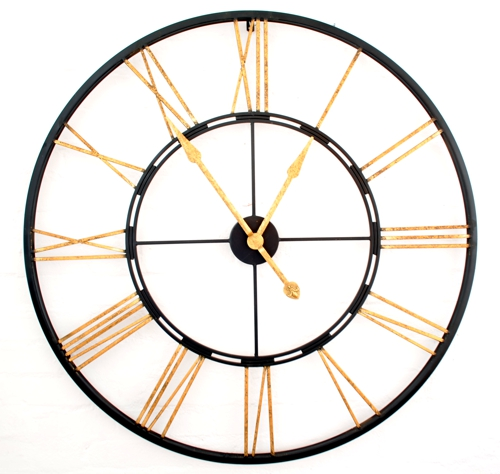 large round metal skeleton wall clock with black surround and centre, gold antique finish roman numerals and hands