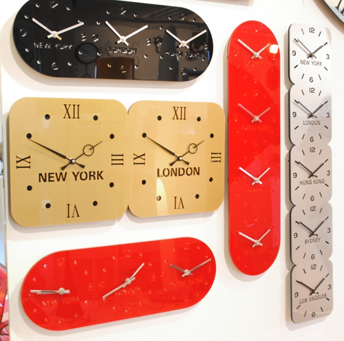 five different glass acrylic timezone wall clocks