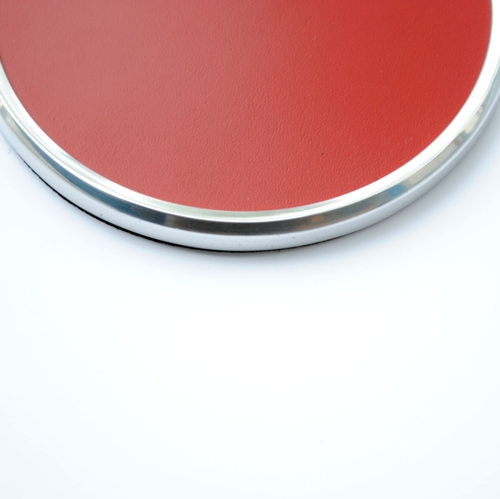 close up of metal rim red leather round coaster