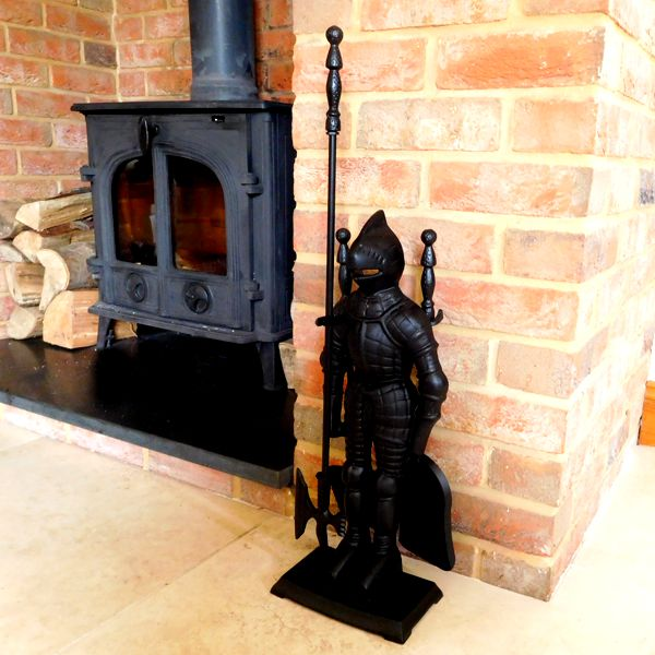next to a log burner English Knight Fireside Tool Companion Set