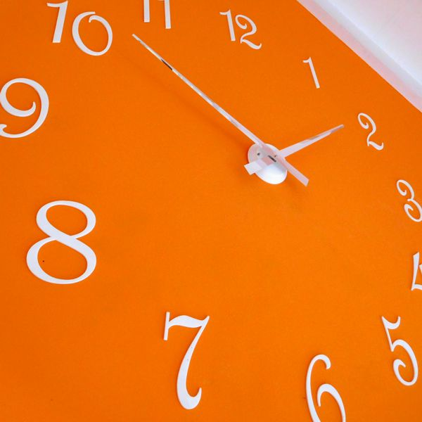 Roco Verre white Gloss Luna Hand Clock with white french numbers on orange wall