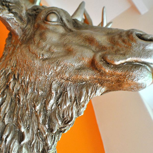 close up of large silver resin trophy wall stag head