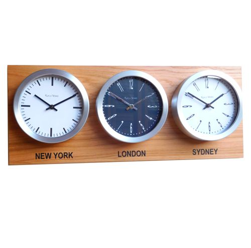 face on view of three dial time zone clock on oak board