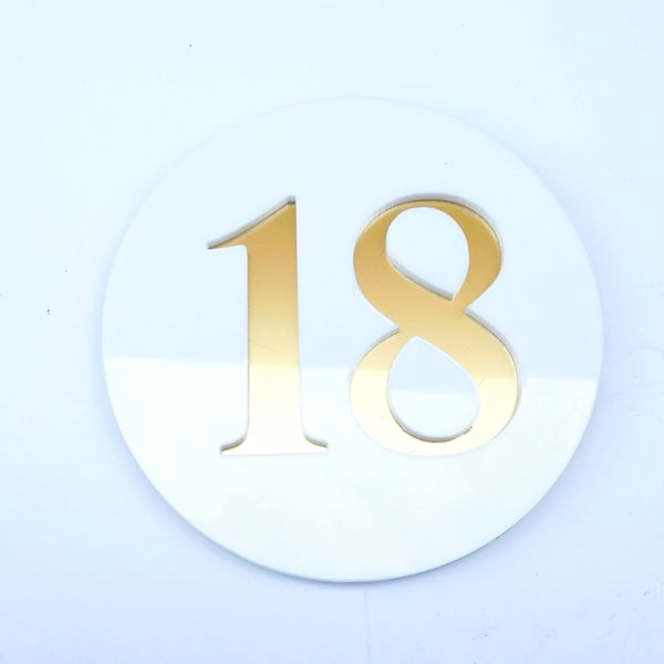 gloss white and brass house number sign