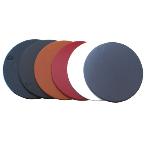 a row of round leather coasters in tan, white, brown, black and red