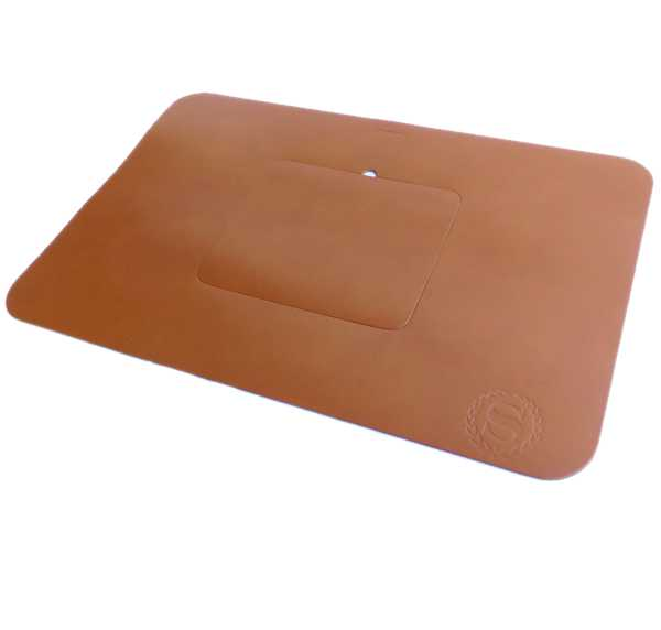 large tan leather desk mat on white table