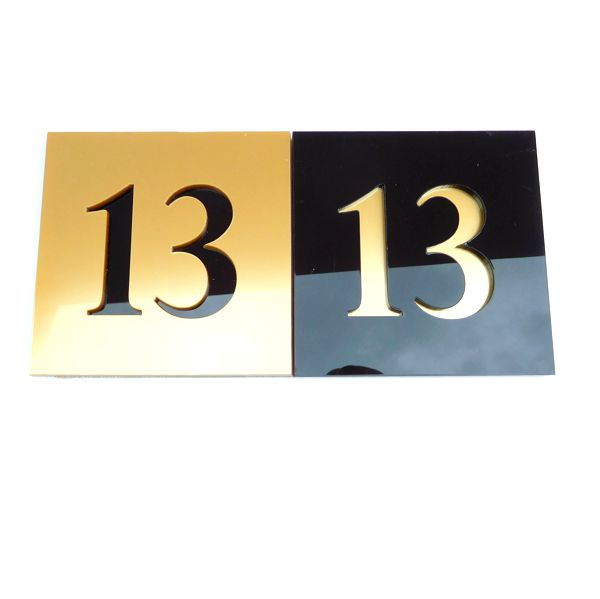 black and brass square house number signs