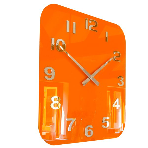 close up of large orange retro style gloss acrylic clock on a kitchen wall