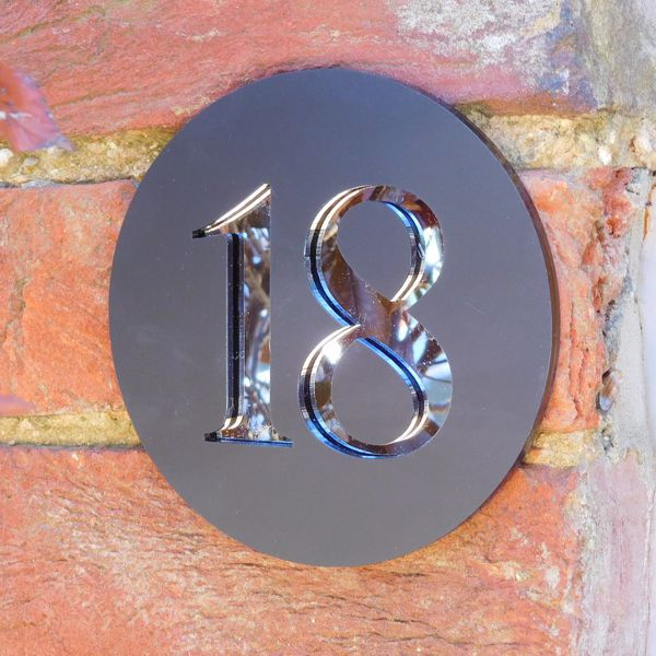 slate effect and chrome house number sign
