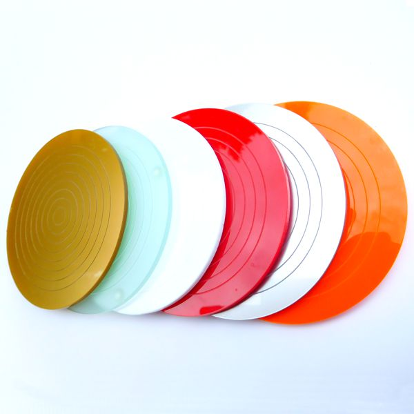 a row of gloss acrylic round placemats multiple colours